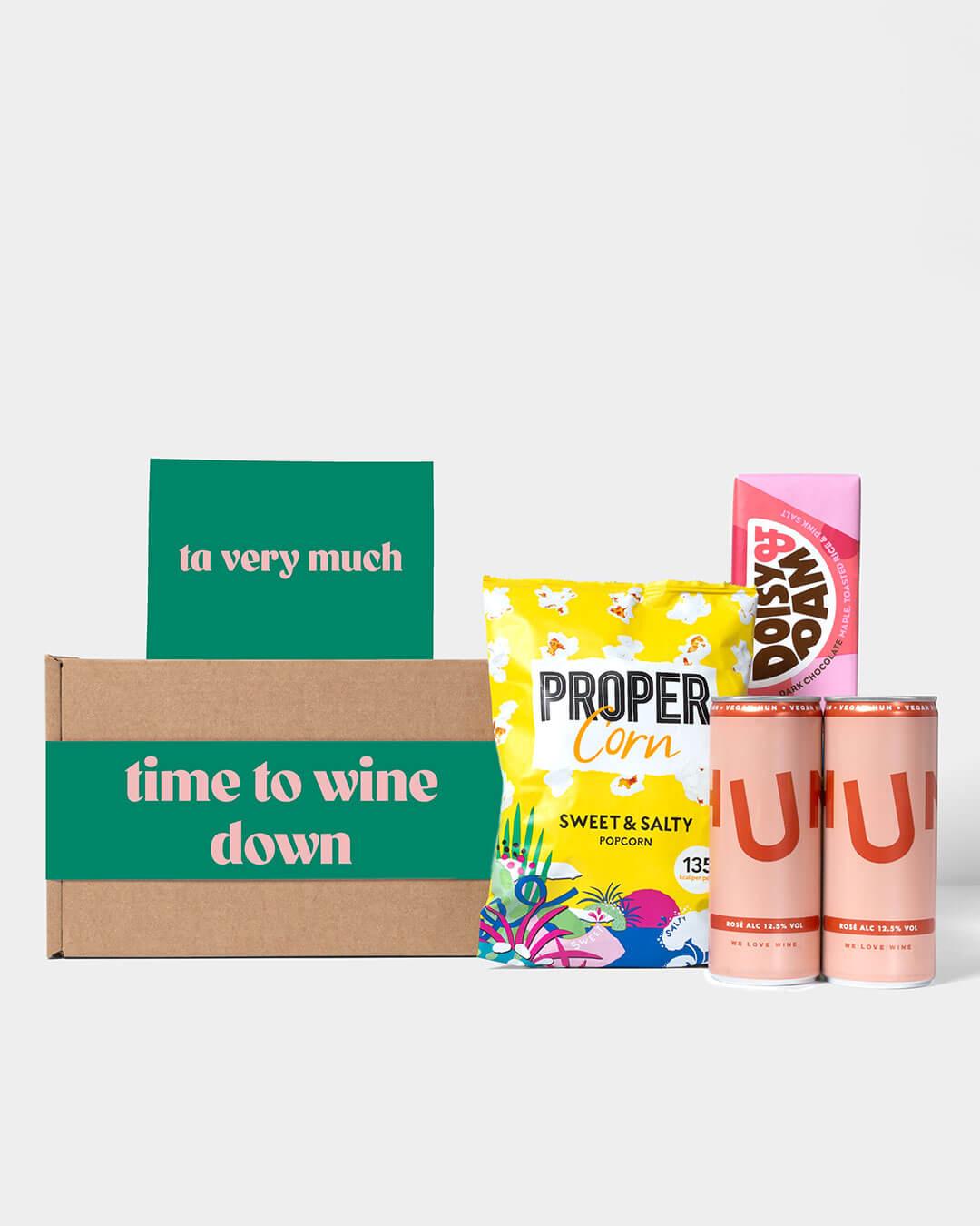 Wine box and contents including rosé Hun wine, Propercorn popcorn and Doisy & Dam Chocolate