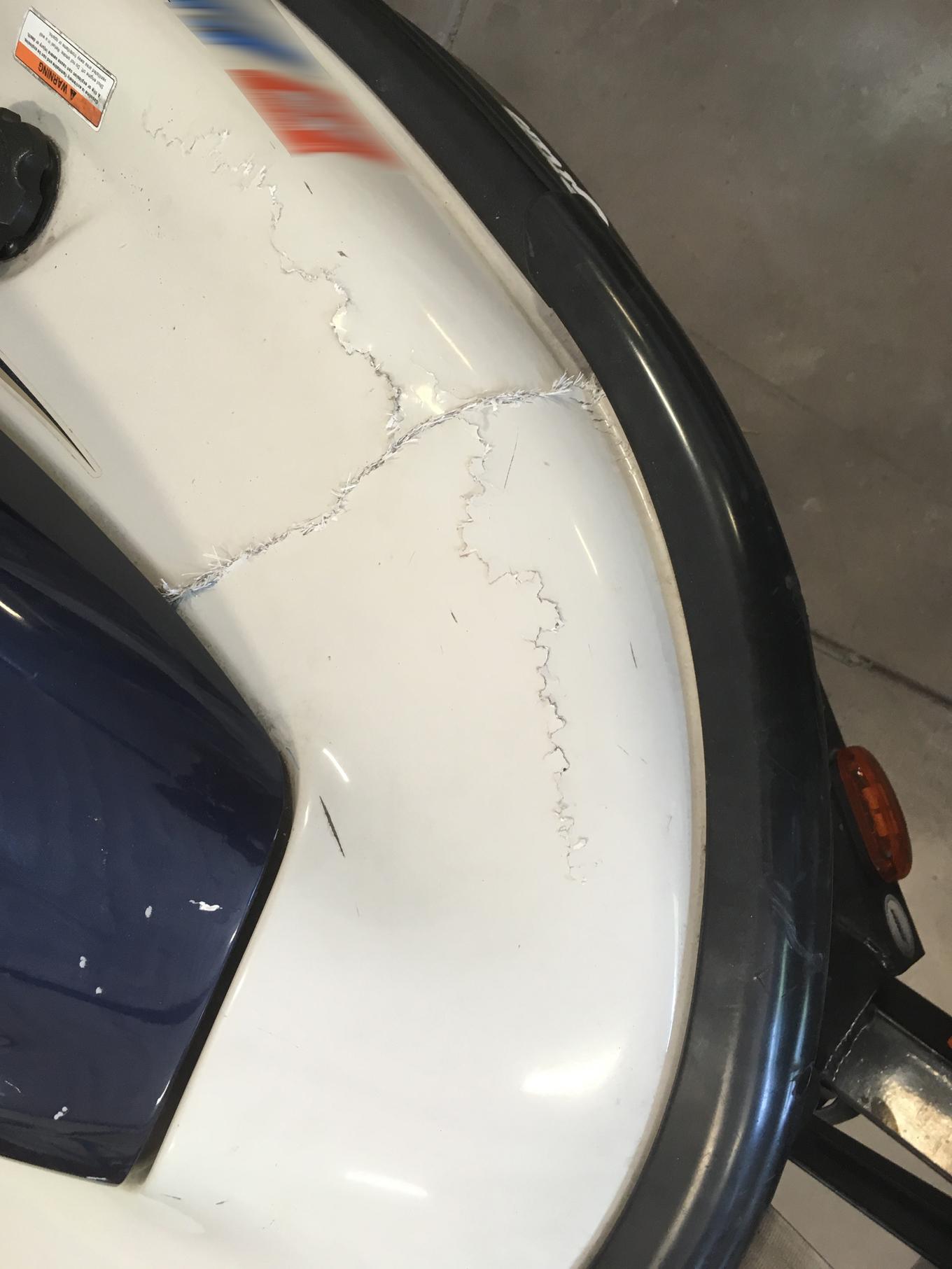 Damaged jet ski with cracks.