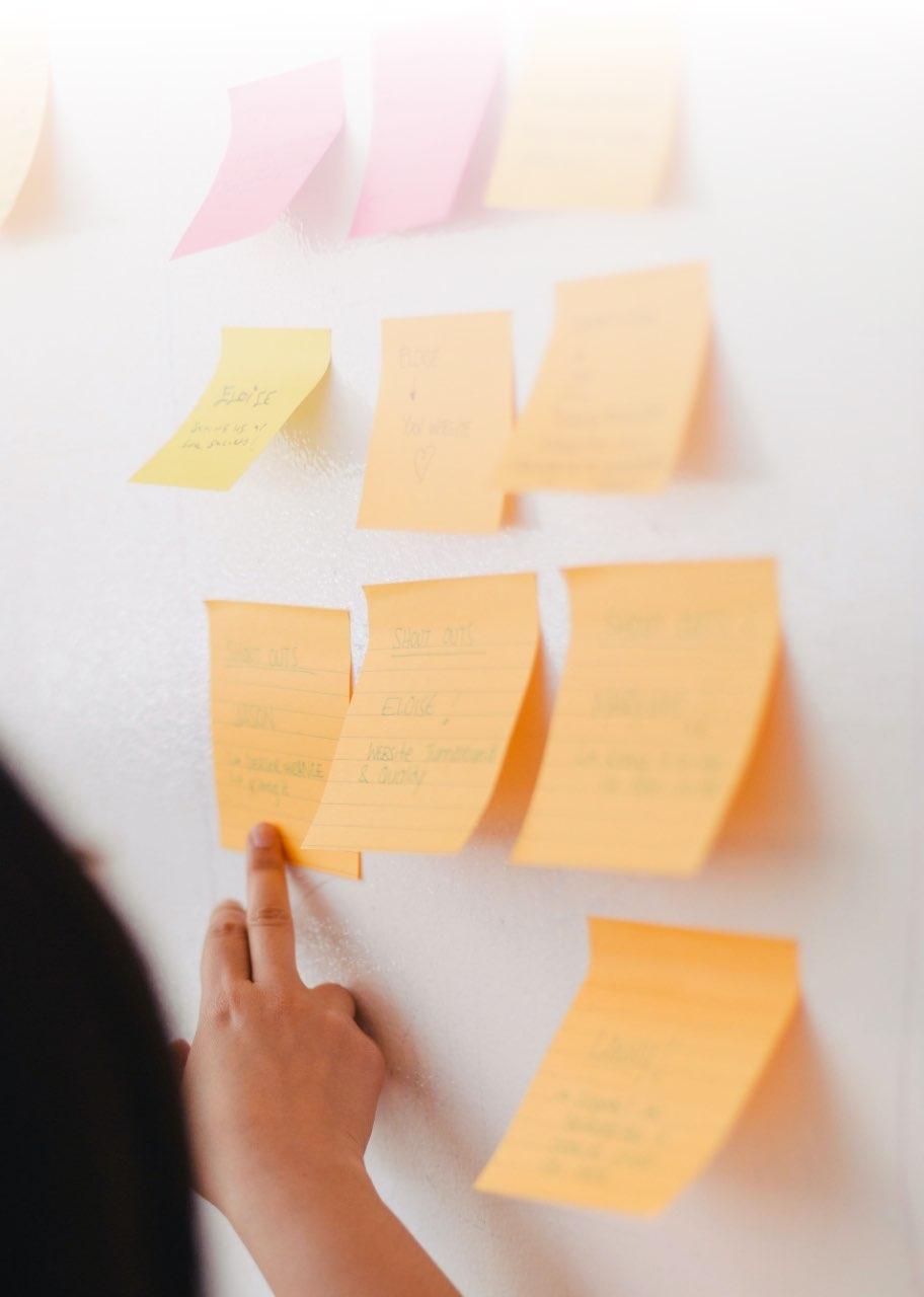 A workshop board full of post-it.
