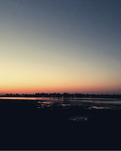 A colorful sunrise over a waterway