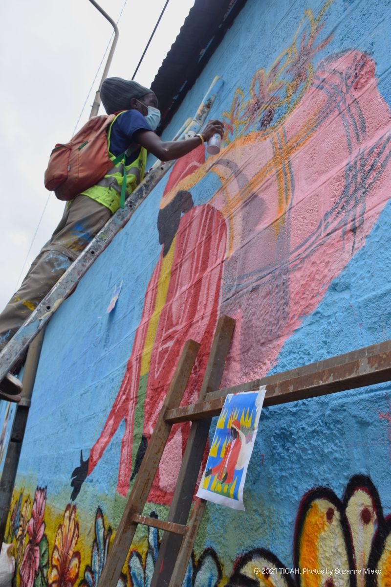 Artist on a ladder painting a mural at Muthurwa roundabout