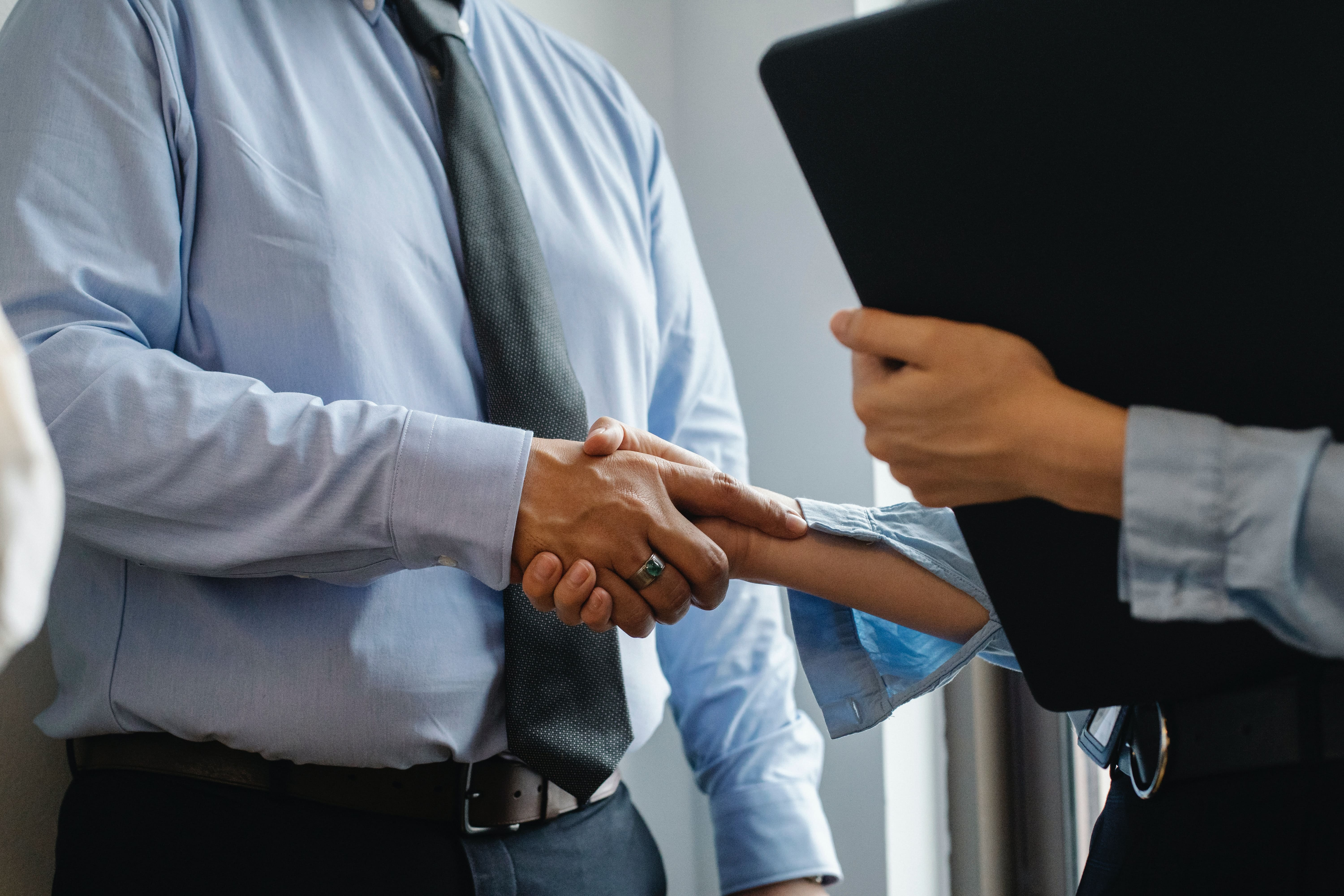 Accountants shaking their hands.