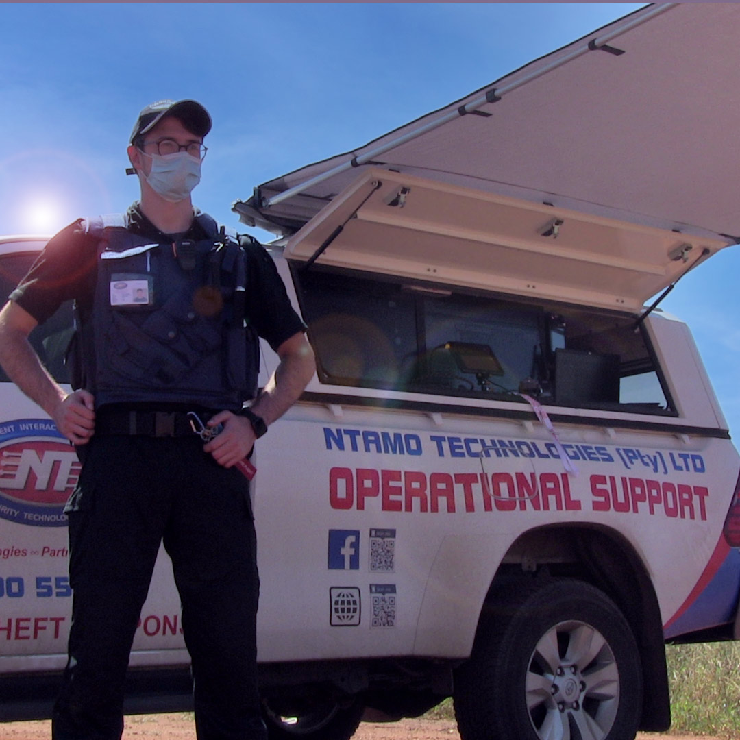 Drone pilot standing beside the operational support vehicle.