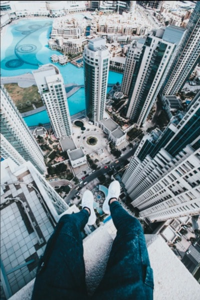 human sitting down on top of a building