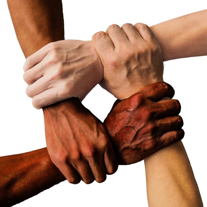 hands of different colors being united