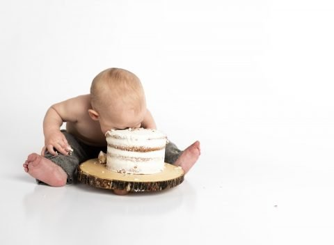 baby with his head in a cream cake