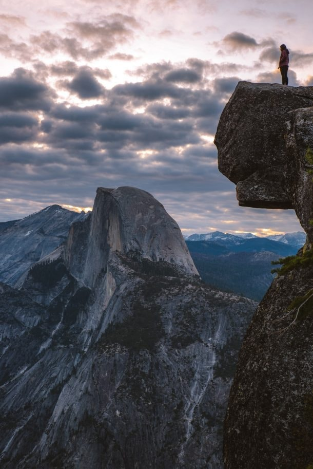 human standing on the edge of a cliff