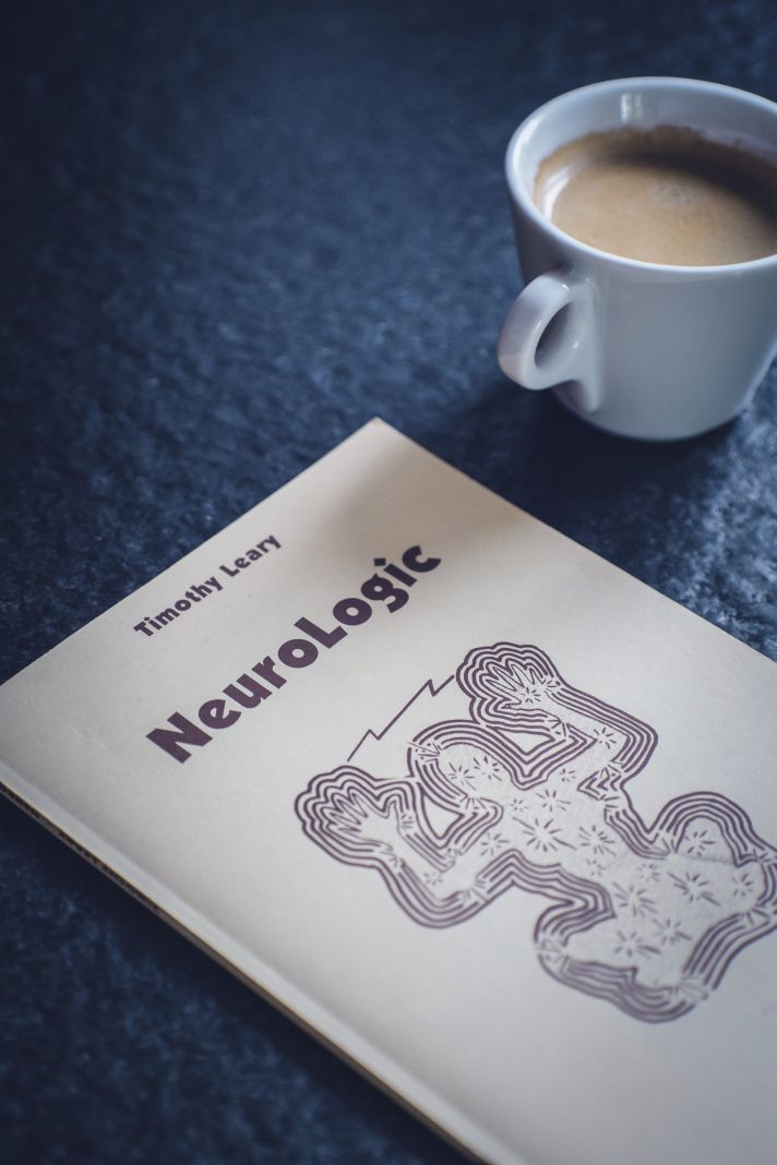 neurologic book next to a cup full of coffee