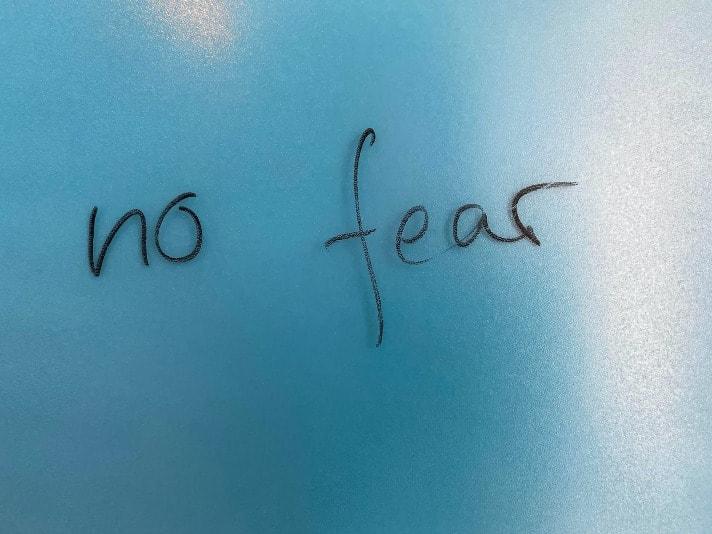 no fear written in black on a light blue background