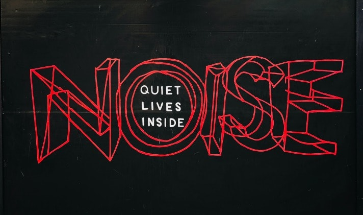 """noise"" written in red 3D script on a black background"