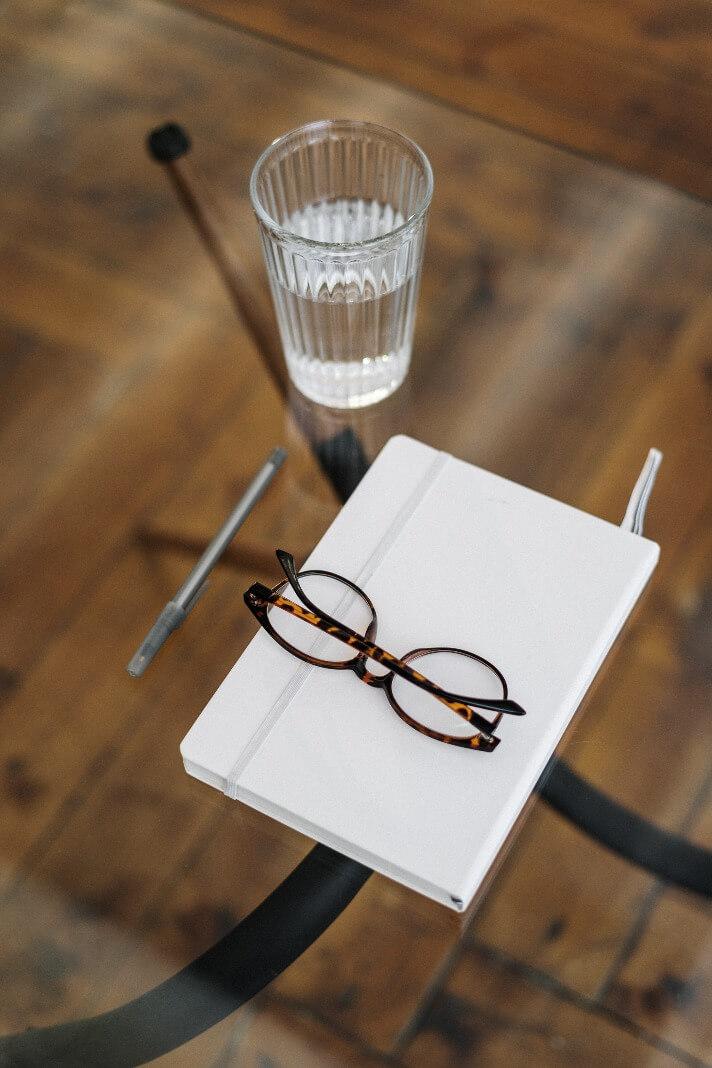 black-framed-eyeglasses-on-white-paper