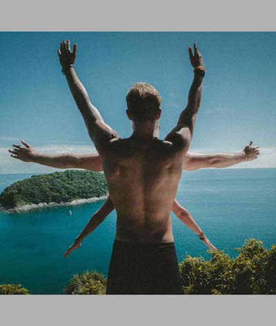 man with 6 arms seen from behind facing an island