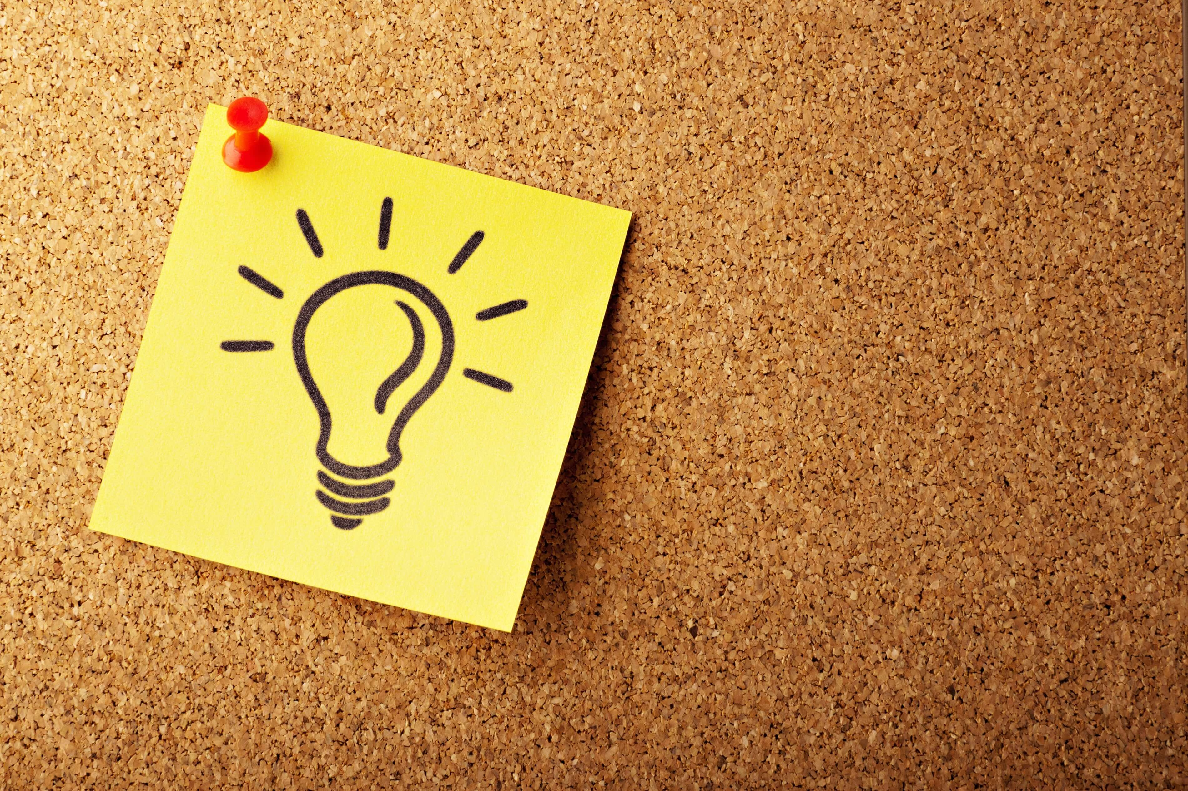 Lightbulb drawn on a post-it note - Photo by AbsolutVision on Unsplash