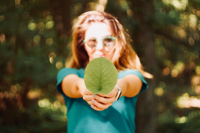 Woman holding leaf