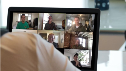 A photo of a group of people in a virtual video chat.