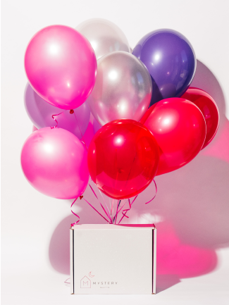 Image of a Mystery product box with balloons tied to it.
