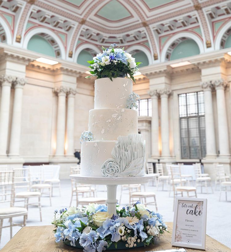 Lush tones of blue, white, silver and delicate floral
