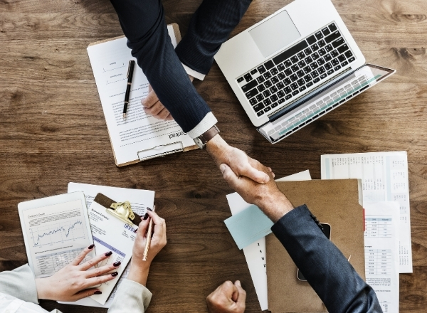 Image of Firm Recruiter shaking hands with newly hired employee