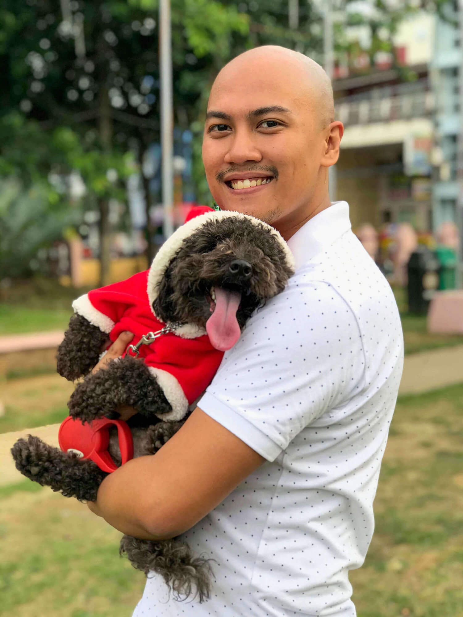 Eli with his cute black poodle, Miggy