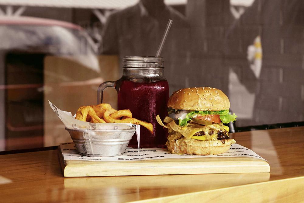 A photo of hamburger and fries