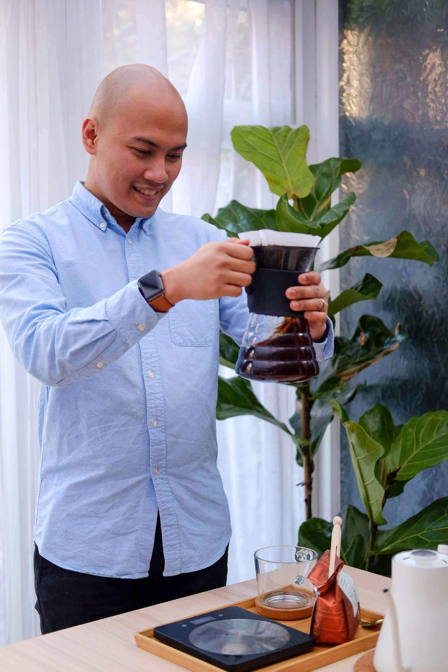 Eli brewing coffee using the Hario V60 drip method