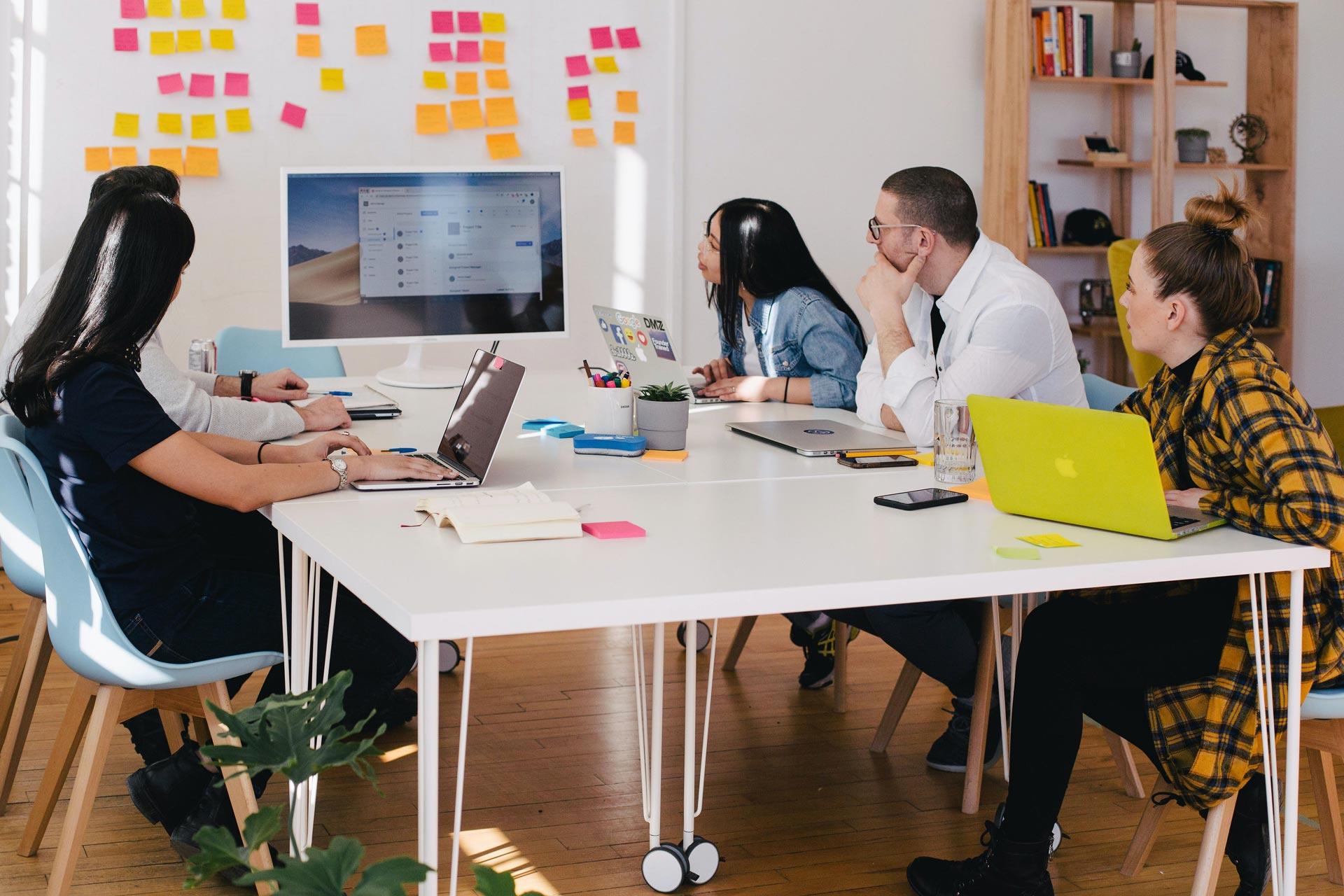 Team Working Around Desk