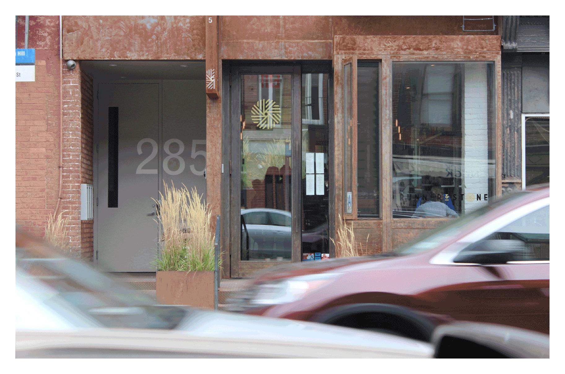 Runner & Stone storefront with branding on door and window.
