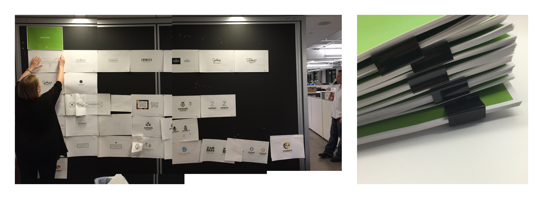 Photo showing logo concepts pinned up on blackboard in office