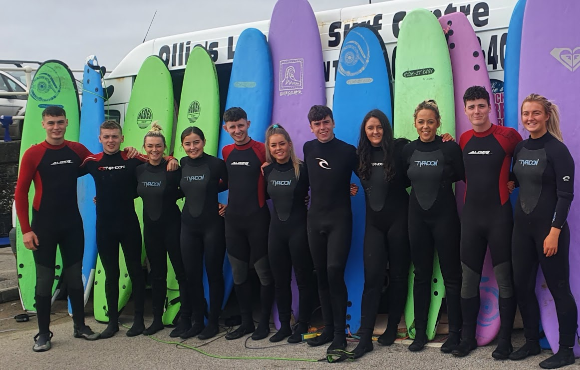 Ollie's Surf School on Lahinch beach men and women learning to surf