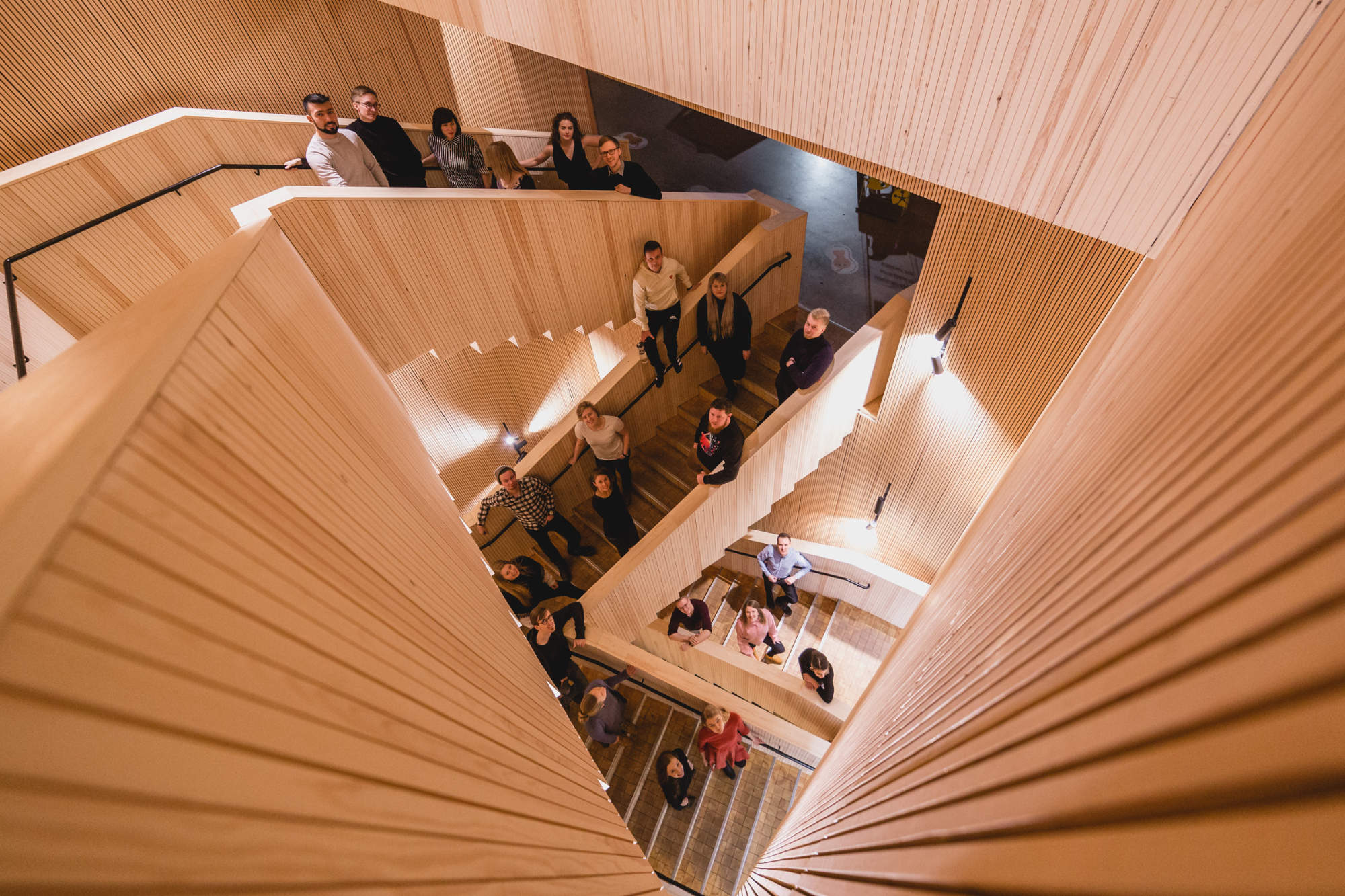 A photograph taken from above a staircase where people are standing.