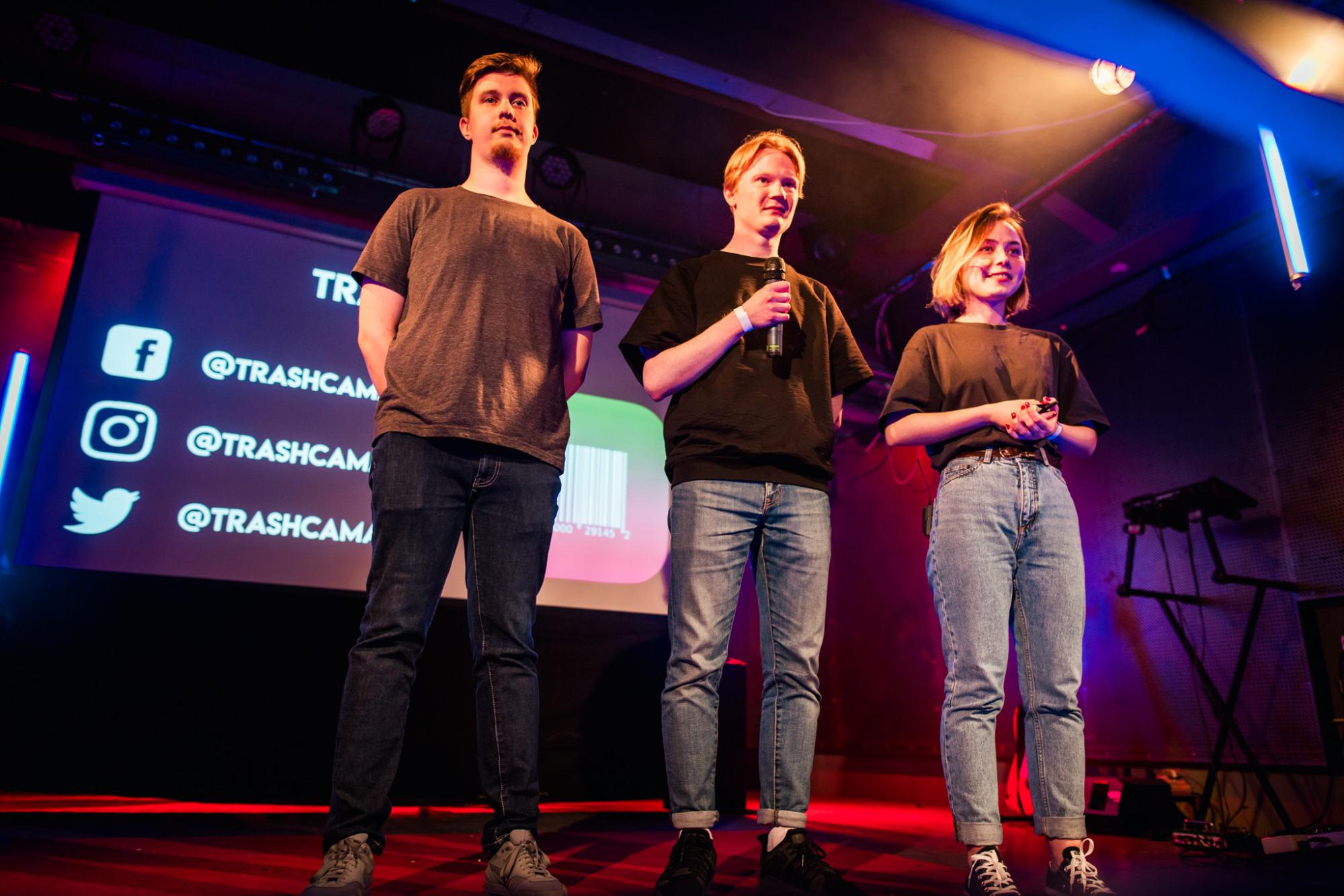 Three people on a stage