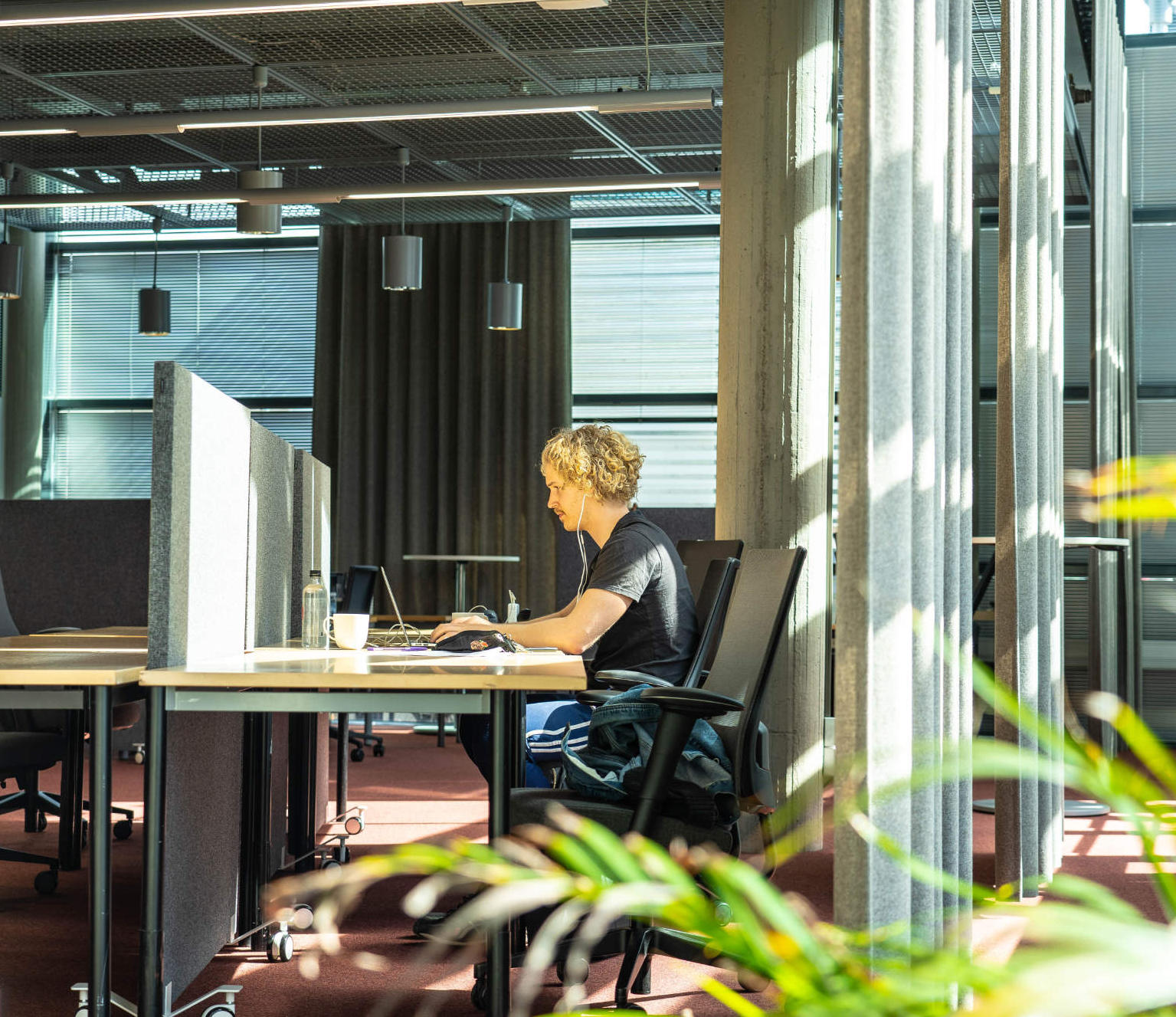 A person working at a desk at Terkko Health Hub, our Meilahti location.