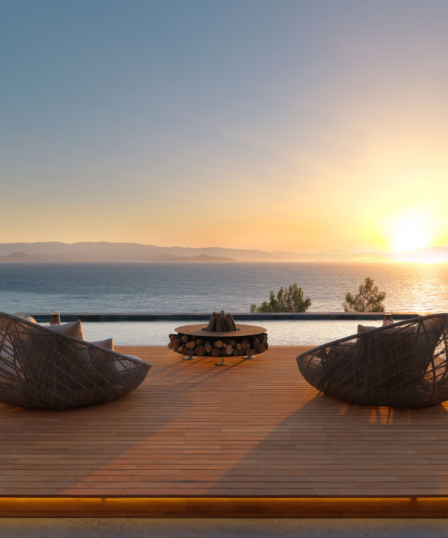 Luxury seating overlooking the sea at sunset
