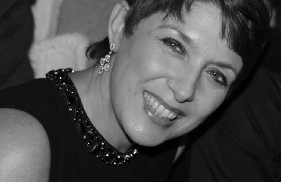 Head and shoulder shot of Isabel Tapp smiling at the camera