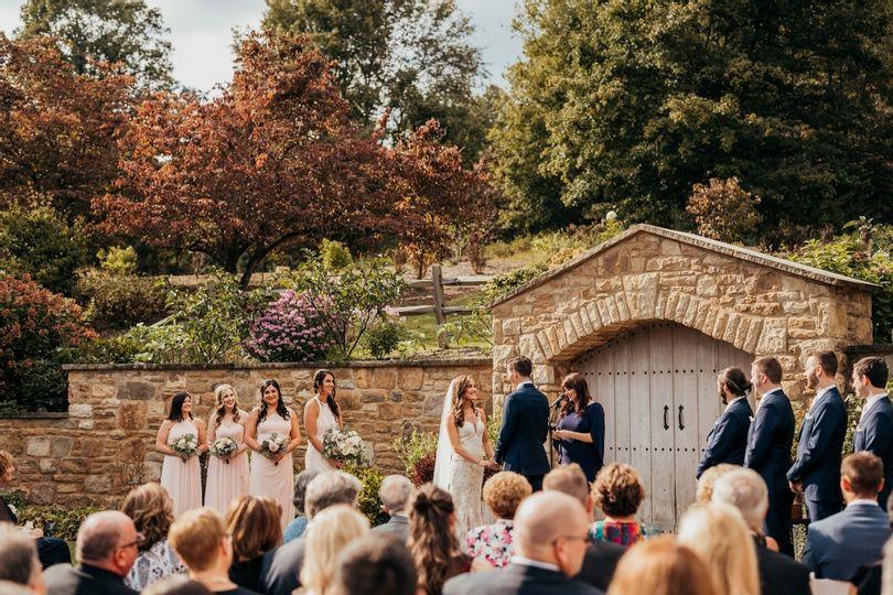 A wedding ceremony in an outdoor venue