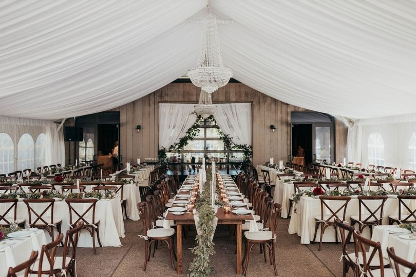 A wedding venue with tables and chairs