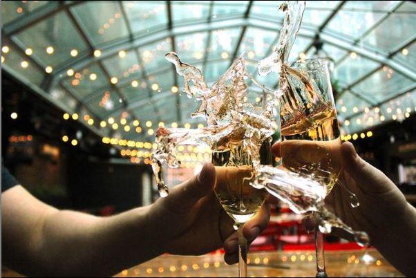 Drinks clinking at Sienna Mercato