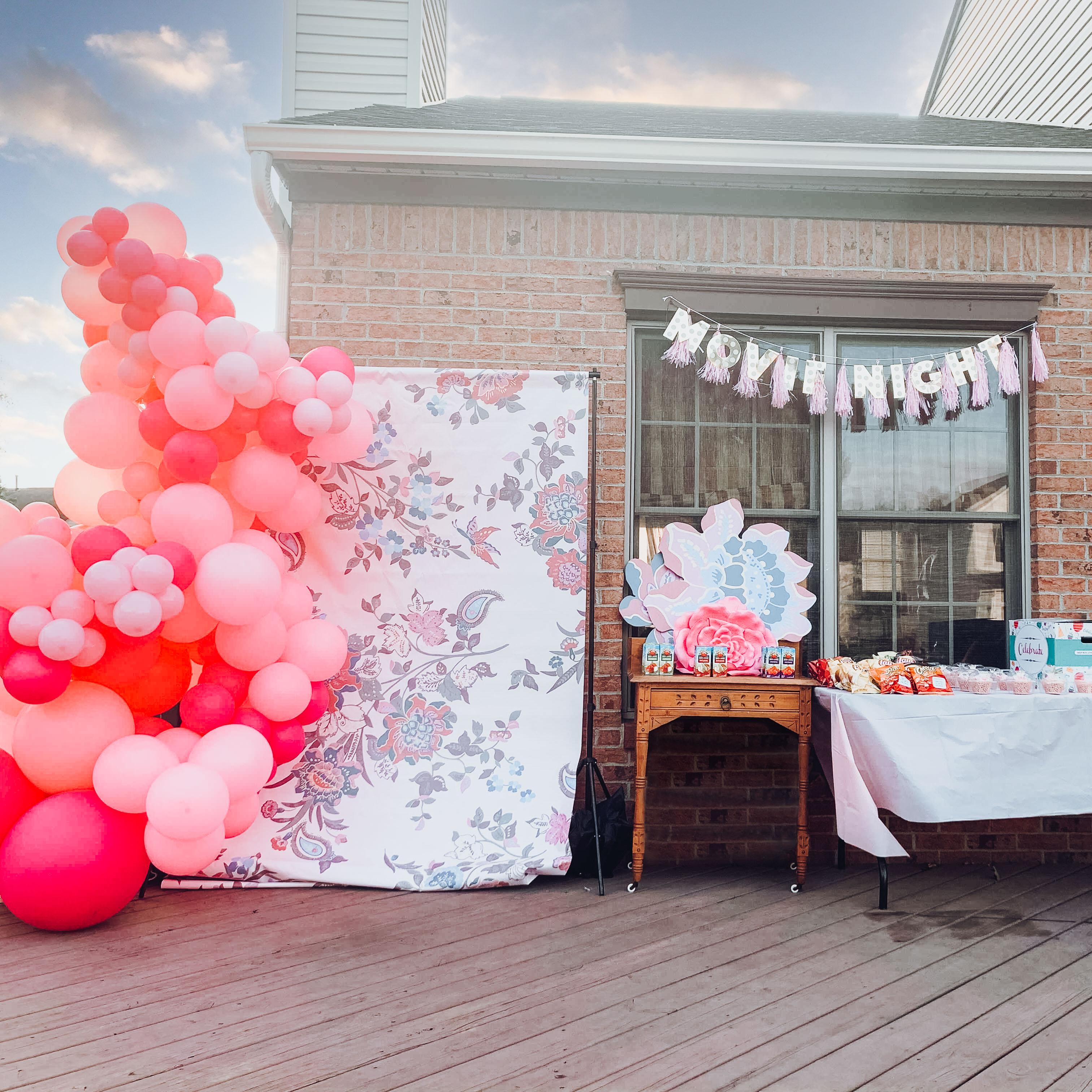 A pink balloon backdrop set-up