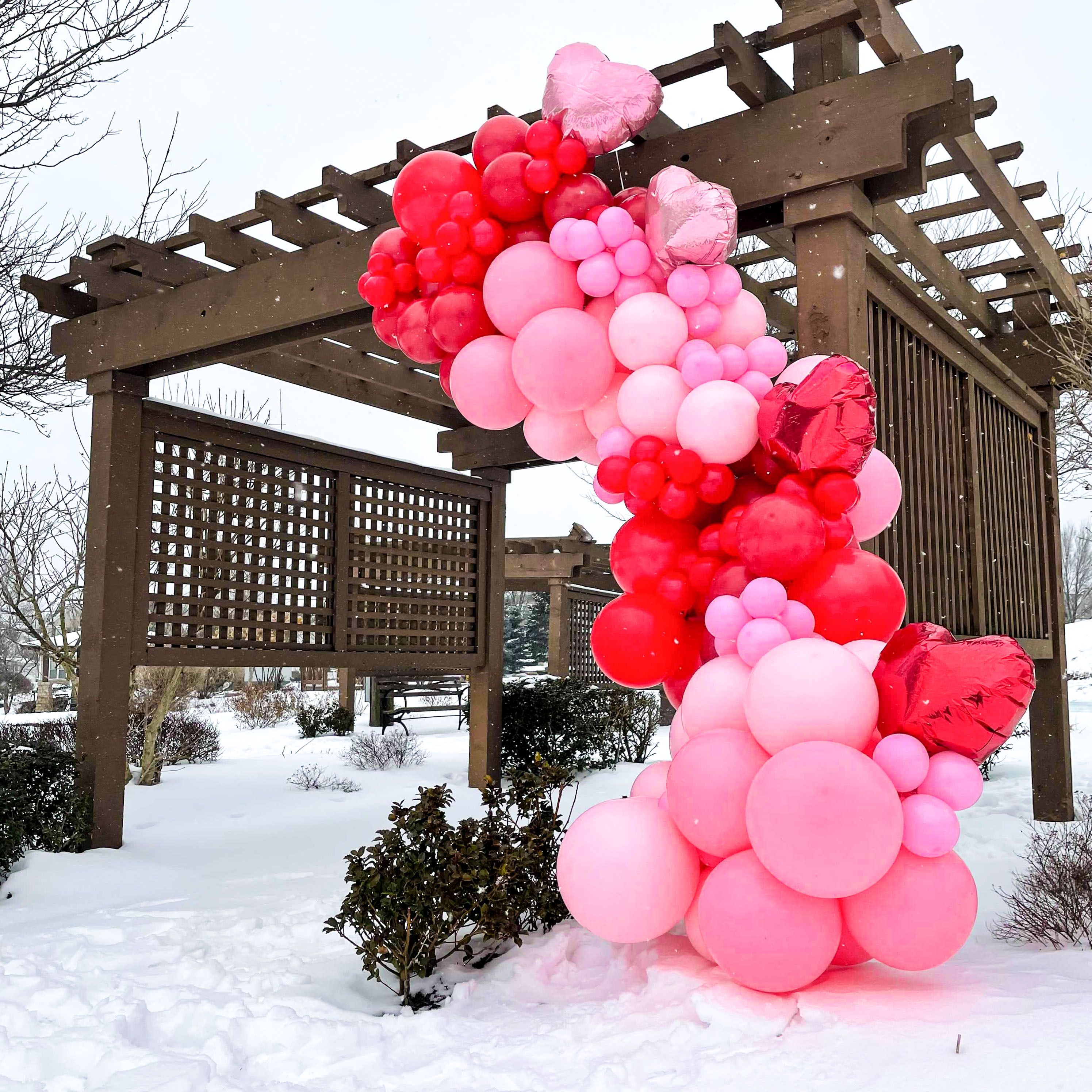 A pink and red balloon garland in the show