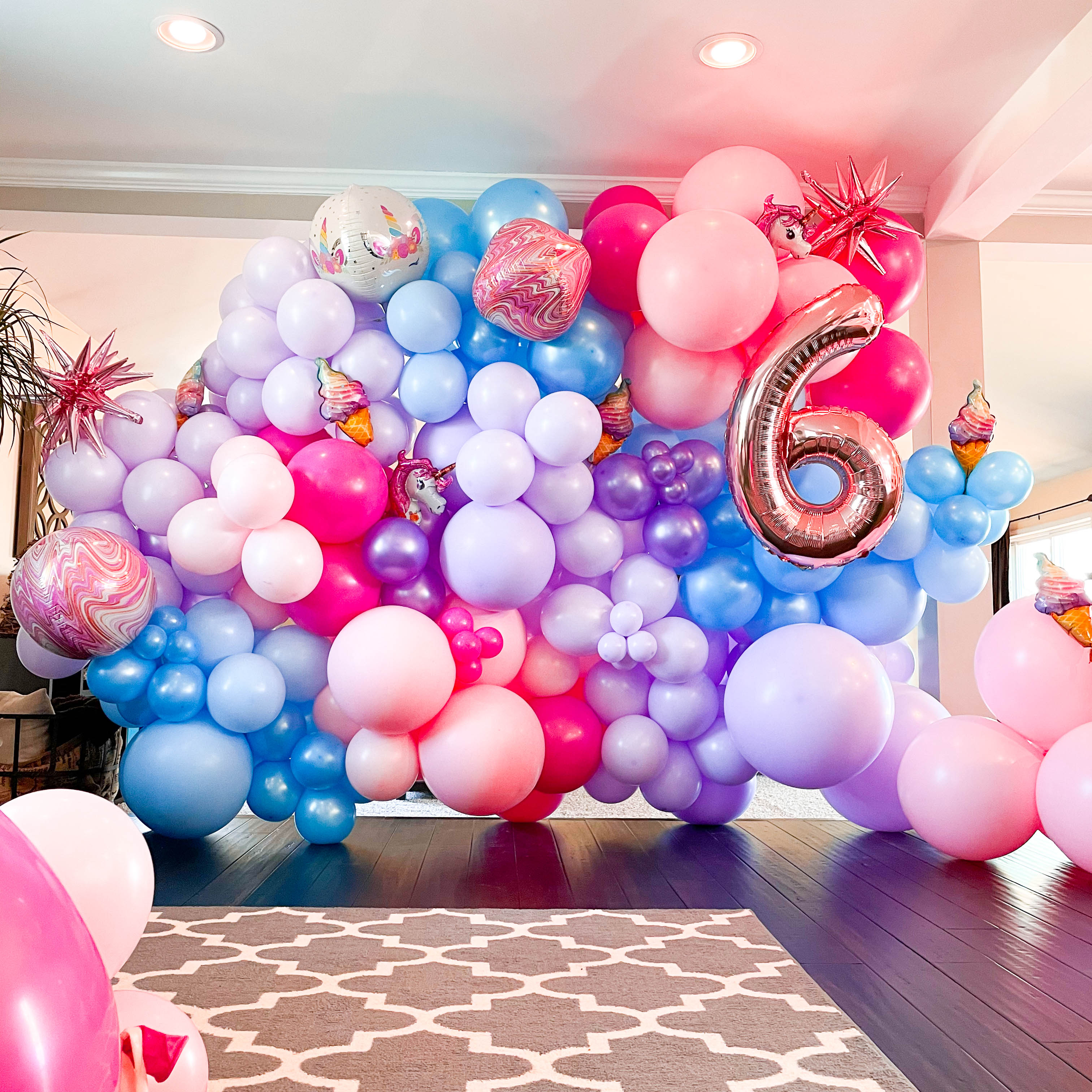 A pink, purple, and blue photo wall