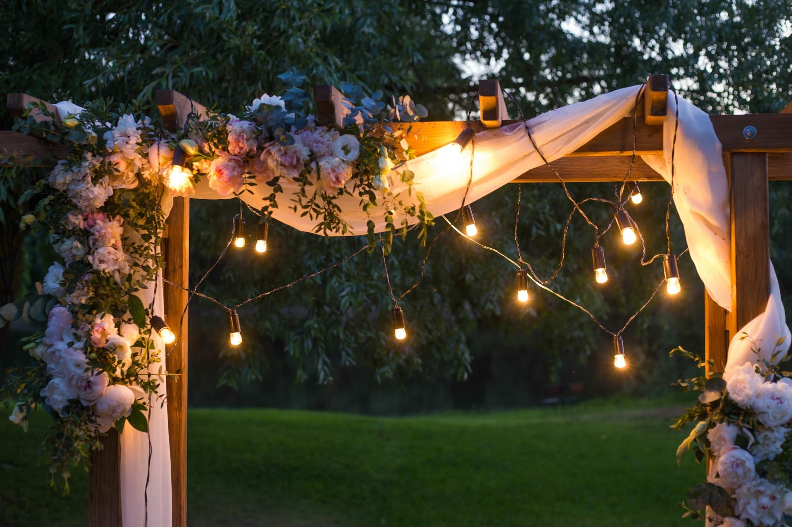 Wooden frame with florals and string lights