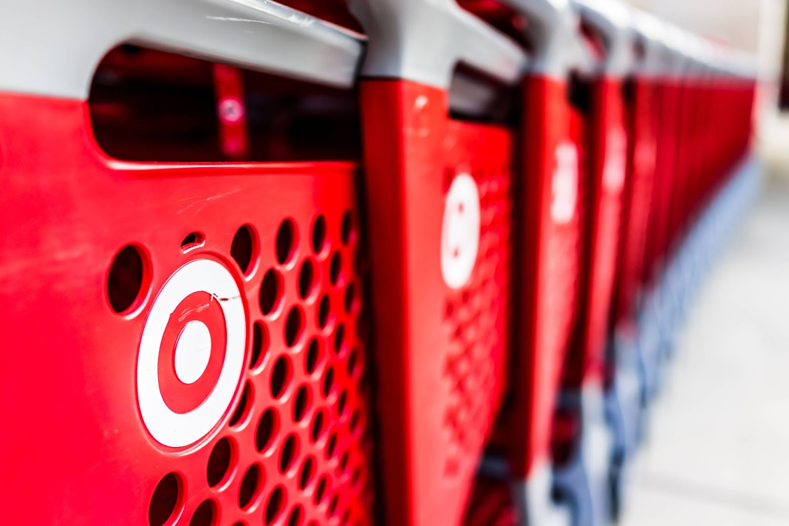 Many target shopping carts in a row