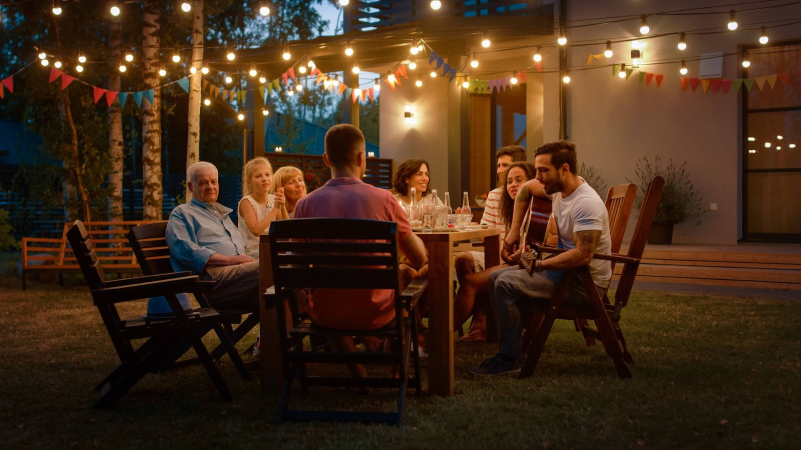 Outdoor dinner party with people sitting around a table