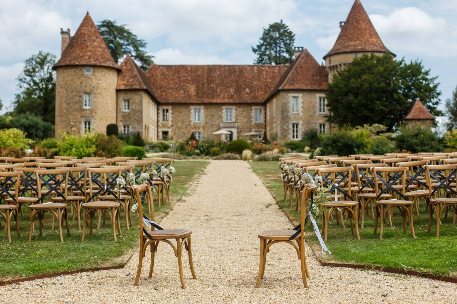 A historic wedding venue with wooden seats on each side of the isle.