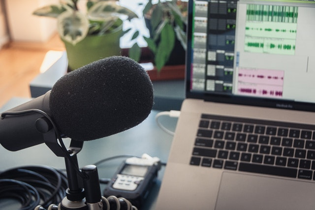 podcast microphone next to computer