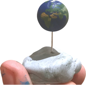 Fingers holding up a tiny painted ball of clay that looks like the Earth