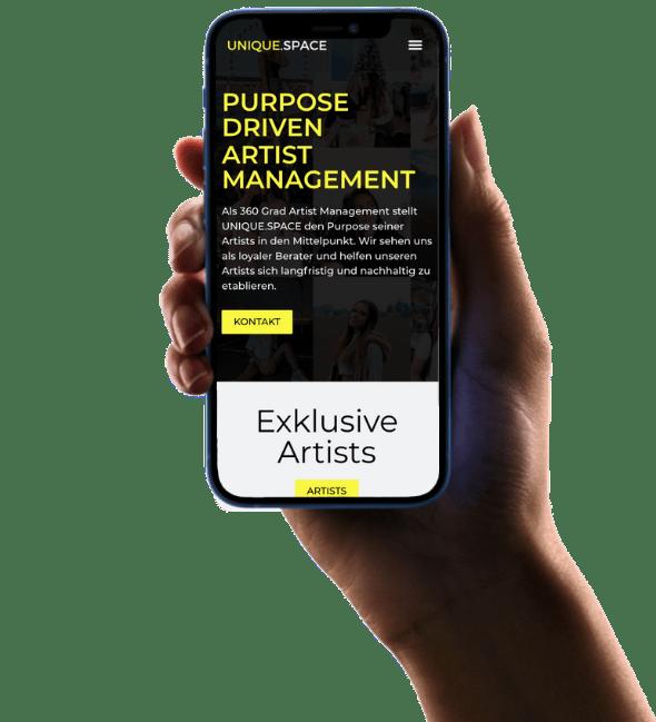 Hand holds Smartphone displays Webdesign