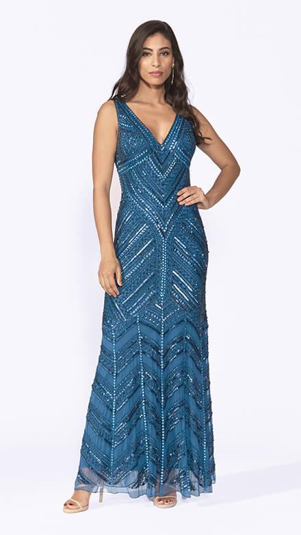 Floor length beaded gown with V neckline and fishtail skirt