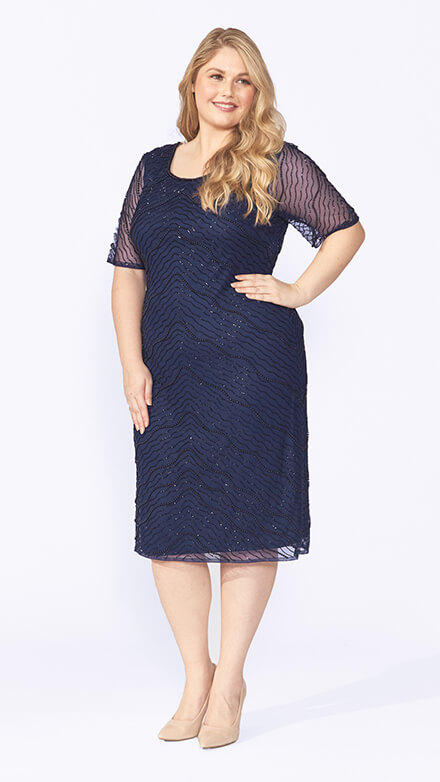 Chiffon cocktail dress with sheer short sleeves and beading in a delicate wave pattern