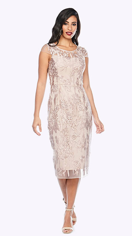 Classic shift style dress with sweetheart neckline and sheer cap sleeve